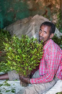 Somalia Photograph - Man Selling Khat At A Market Near Harer by Peter J. Raymond