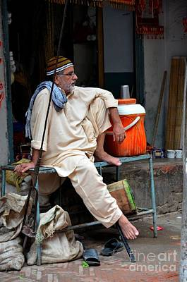 Man Sits And Relaxes In Lahore Walled City Pakistan Art Print