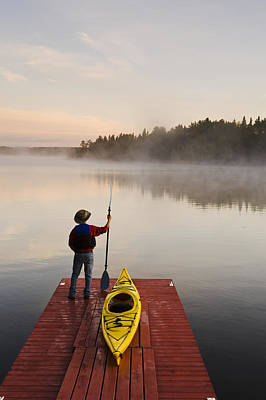 Back To Life Photograph - Man Standing By Kayak On Dock In by Dave Reede
