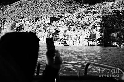 man taking photos with smartphone during boat ride along the colorado river in the grand canyon Ariz Art Print by Joe Fox