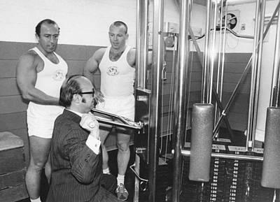 Man Tries Weight Machine Art Print by Underwood Archives
