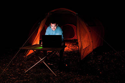 Camping Photograph - Man Using Laptop Outside A Tent by Matthew Oldfield