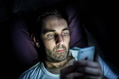 Man Using Smartphone In Dark Art Print by Samuel Ashfield