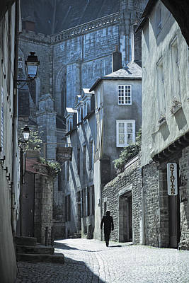 Man Walking Away Down An Ancient Old Medieval Street In Vannes Brittany France Europe Art Print by Jon Boyes