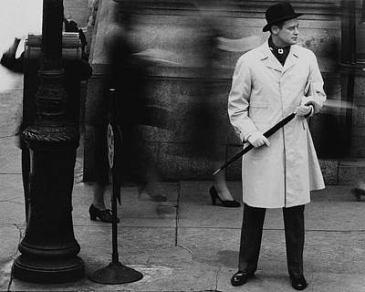 Photograph - Man Wearing A Raincoat by John Rawlings