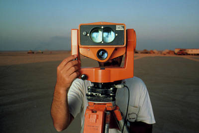 Man With A Survey Instrument In The Libyan Dessert Art Print by Joe Pasieka/science Photo Library