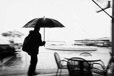 man with backpack and umbrella walking hurrying in the rain north Vancouver BC Canada deliberate mot Art Print