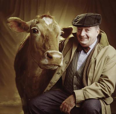 Man With Cow Art Print by Ken Tannenbaum