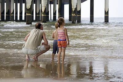 Scheveningen Pier Photograph - Man With Son And Daughter At The Pier In Scheveningen Netherlands by Ronald Jansen
