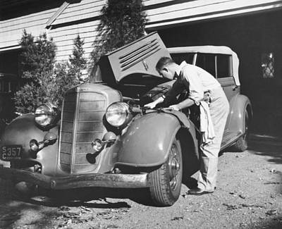 One Young Man Only Photograph - Man Working On His Car by Underwood Archives