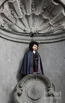 Boy Peeing Photograph - Manneken Pis In Brussels Dressed As Dracula by Kiril Stanchev