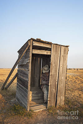 Mannequin Sitting In Old Wooden Outhouse Art Print