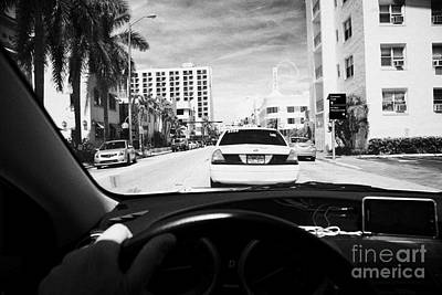Mans Hand On Wheel Driving Along Collins Ave In Miami South Beach Following A Yellow Cab Florida Usa Art Print by Joe Fox