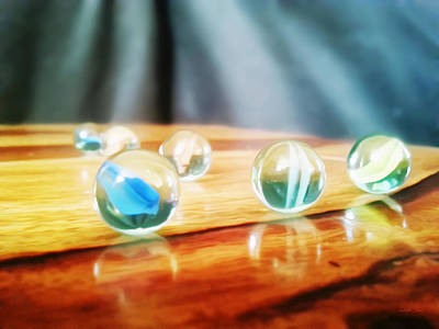 Photograph - Marbles Reflection by Yoursbyshores Isabella Shores