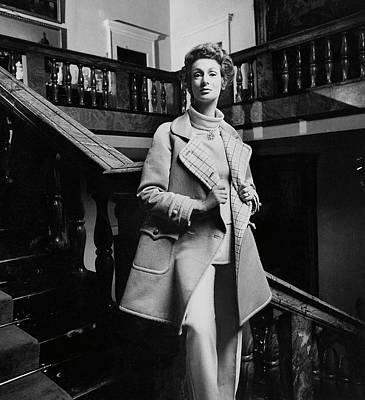 Raincoat Photograph - Marella Agnelli Wearing A Courreges Raincoat by Henry Clarke