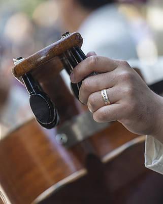 Western Art - Mariachi Tuning a Guitarron by Robert Ullmann