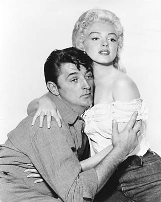 Marilyn Photograph - Marilyn Monroe And Robert Mitchum by Retro Images Archive