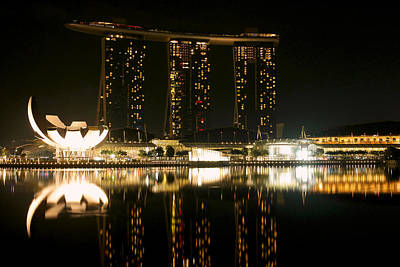 Marina Bay Sands And The Artscience Museum From Across Marina Bay At Night Art Print by Chris Quek