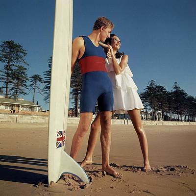 Marisa Berenson And Nat Young On A Beach Art Print by Arnaud de Rosnay