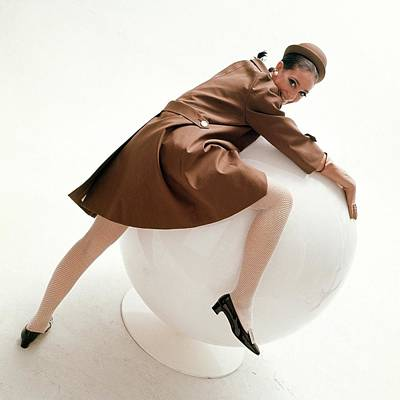Raincoats Photograph - Marisa Berenson Posing On A Ball by Bert Stern