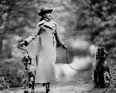 Arnaud-de-rosnay Photograph - Marisa Berenson Walking Two Dogs by Arnaud de Rosnay