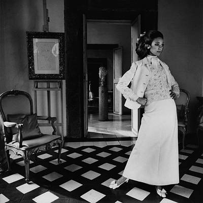 Valentino Photograph - Marisa Berenson Wearing A Cotton Forneris Evening by Henry Clarke
