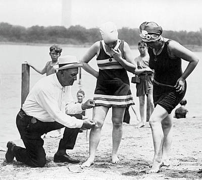 Moral Photograph - Measuring Bathing Suits by Underwood Archives