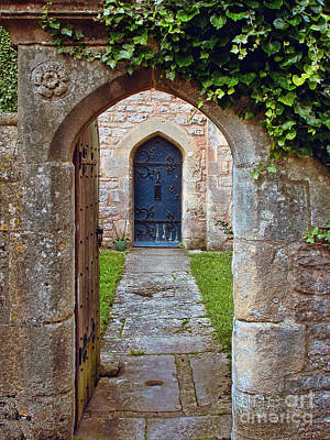 Photograph - Medieval English Stone Archway And Ornate Wooden Door by Menega Sabidussi