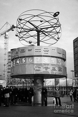 meeting place at the world clock Weltzeituhr at Alexanderplatz with reconstruction work in background east Berlin Germany Art Print by Joe Fox