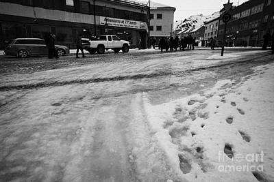 melting ice and snow on street surface holmen Honningsvag finnmark norway europe Art Print by Joe Fox