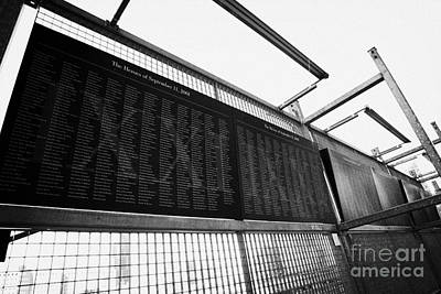 Memorial Wall With Names Of Nine Eleven Victims On The Fence At World Trade Center Ground Zero Print by Joe Fox