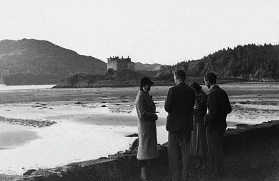 Men And Women Standing On A Bank Of A Lake Art Print by John Mcmullin