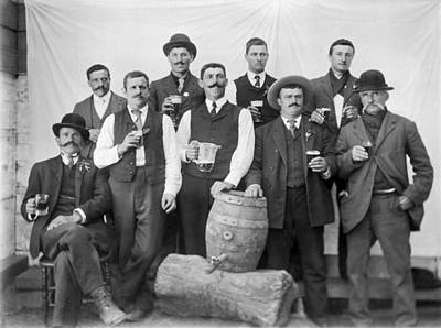 Mans Hat Photograph - Men Around A Keg Of Beer by Underwood Archives