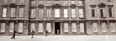 Looking Back Photograph - Men Carrying Boxes, Moving To A New by Panoramic Images
