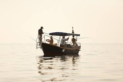 Men Go Fishing From A Boat Art Print by Serhii Odarchenko