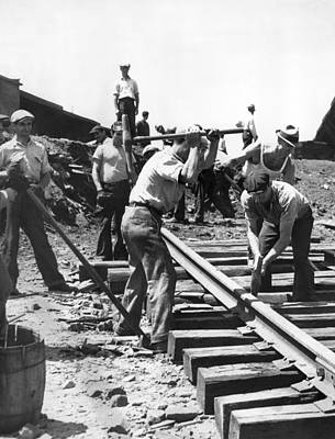 Railroad Tracks Photograph - Men Laying Railroad Track by Underwood Archives