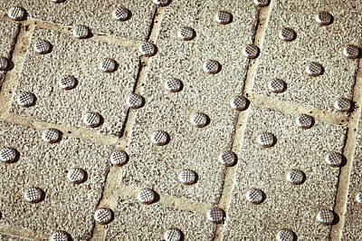 Paving Photograph - Metal Studs by Tom Gowanlock