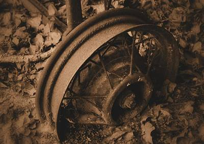 Photograph - Metal Wheel In Sepia by Nadalyn Larsen