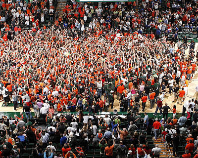 Photograph - Miami Hurricanes Fans Rush The Court At Bankunited Center by Replay Photos
