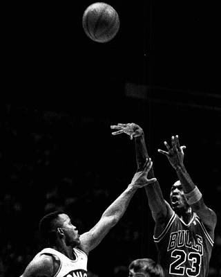 Air Jordan Photograph - Michael Jordan Shooting Over Another Player by Retro Images Archive