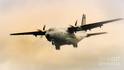 Photograph - Military Transport Aircraft Coming Out Of The Mist by Nick  Biemans