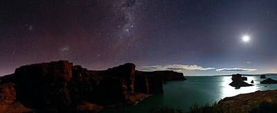 Milky Way And Moon Over Reservoir Art Print by Luis Argerich
