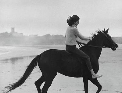 Minnie Cushing Riding A Horse Art Print by Toni Frissell