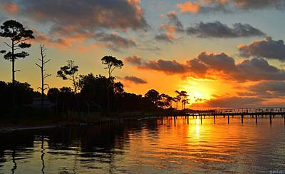 Photograph - Mirrored Sunrise Colored Clouds And Pine Tree Silhouettes On Calm Santa Rosa Sound by Jeff at JSJ Photography