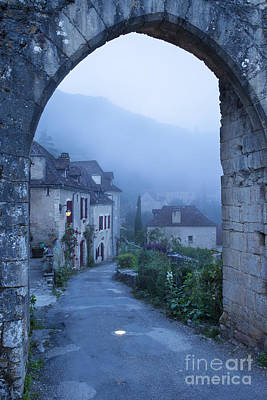 Misty Dawn In Saint Cirq Lapopie Art Print by Brian Jannsen