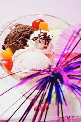 Strawberry Sundae Photograph - Mixed Ice Cream With Fruit, Cream And Cocktail Umbrella by Foodcollection