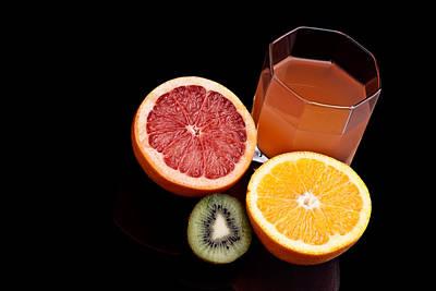 Photograph - Mixed Orange Kiwi And Grapefruit Juice by Marek Poplawski
