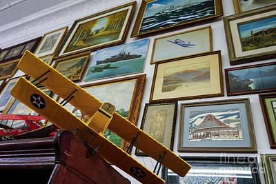 Model Airplanes Near Wall Of Framed Artwork  Art Print