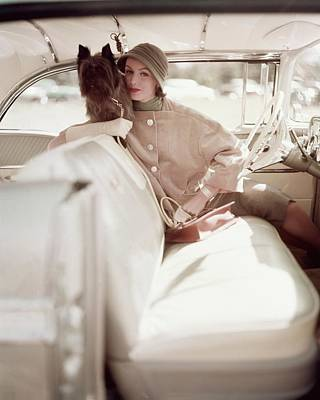 Photograph - Model Posing With A Dog In The Front Seat by Karen Radkai