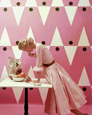 1950s Fashion Photograph - Model Putting On Lipstick by Richard Rutledge